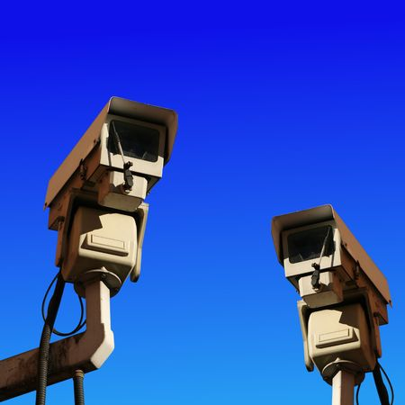 close circuit camera: two CCTV cameras against blue sky illustration
