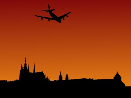 Plane arriving in Prague with St Vitus cathedral and castle photo