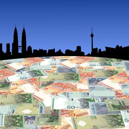 scatter: Kuala Lumpur skyline with Malaysian Ringgit foreground Stock Photo