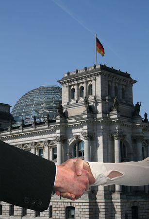 handshake between business people and German parliament photo