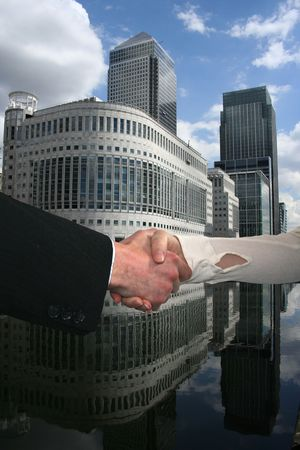 handshake between business people with London docklands skyline Stock Photo - 3646523