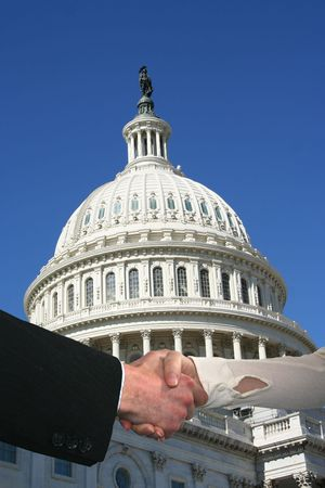 handshake between business people and US Capitol building Stock Photo