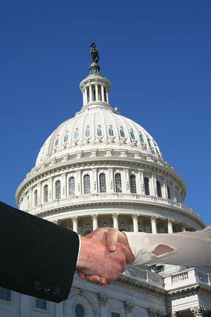 handshake between business people and US Capitol building Stock Photo - 3646519