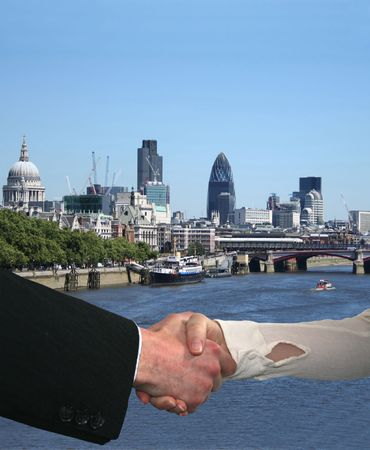 arms trade: handshake between business people with London skyline Stock Photo