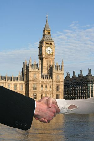 handshake between business people and British parliament Stock Photo - 3664751