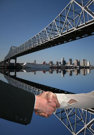 handshake between business people with New Orleans skyline photo