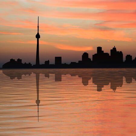 toronto: Toronto skyline at sunset reflected in water Stock Photo