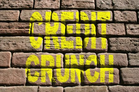Credit crunch painted on brick wall photo