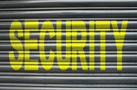 security shutters: security text painted on metal shutters