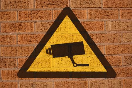 discourage: warning CCTV sign painted on brick wall Stock Photo