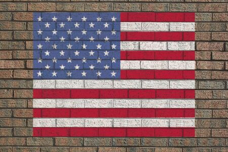 brick and mortar: American flag painted on brick wall