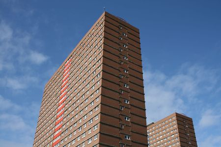 ��low income housing�: Low income public housing tower blocks with blue sky Stock Photo