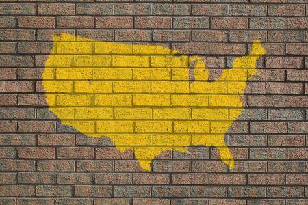 yellow USA map painted on brick wall photo