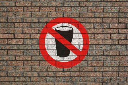intoxicating: No Alcohol sign painted on brick wall