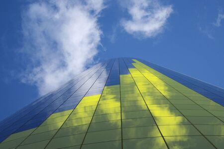 yellow bar chart on tall skyscraper illustration Stock Photo