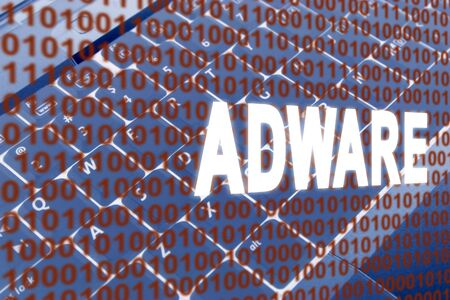 adware: glowing Adware text over binary text and keyboard