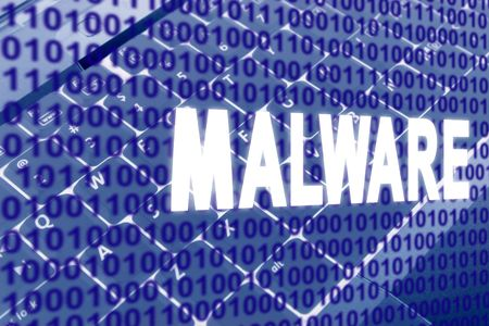 glowing Malware text over binary text and keyboard