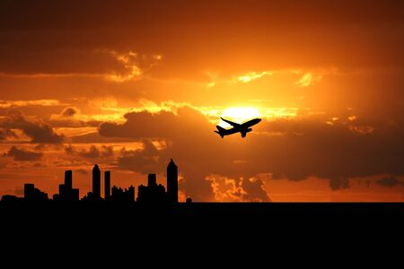 take: plane departing Atlanta at sunset illustration