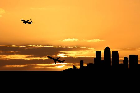departing: planes departing London docklands at sunset illustration Stock Photo