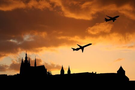departing: planes departing Prague with St Vitus cathedral and castle