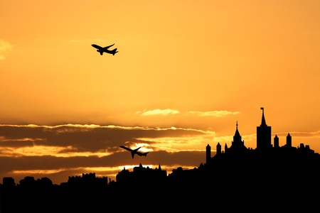 planes departing with Ottawa skyline at sunset photo