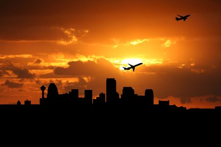 planes departing with Calgary skyline at sunset Stock Photo - 4028740