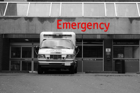 desaturated emergency room entrance with red text