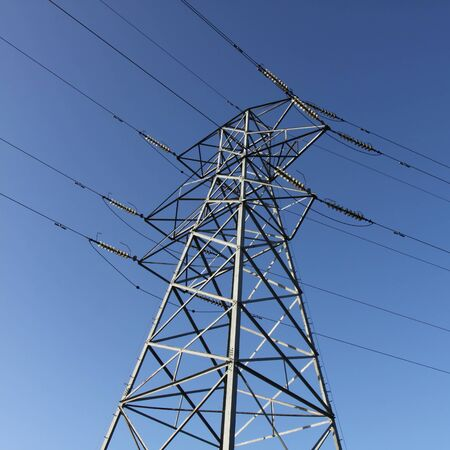 electricity pylon with cables from below photo