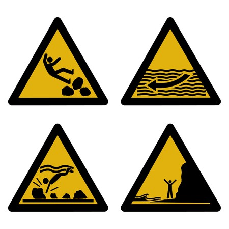 submerged: assorted beach hazard signs slippery rocks strong currents tides Stock Photo