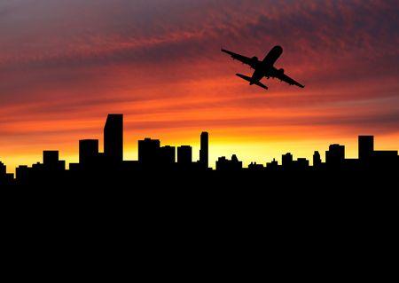 飛行機の日没の図でマイアミを出発