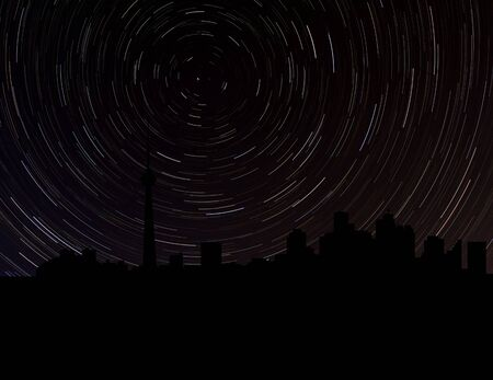 long night: Toronto skyline silhouette with star trails illustration