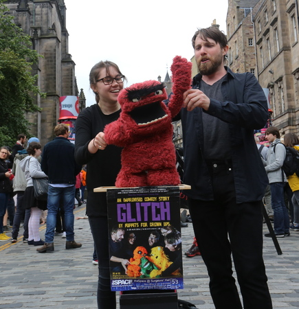 publicize: EDINBURGH- AUGUST 13: Members of Glitch Improv publicize their show Glitch - The Improvised Puppet show during Edinburgh Fringe Festival on August 13, 2016 in Edinburgh, UK