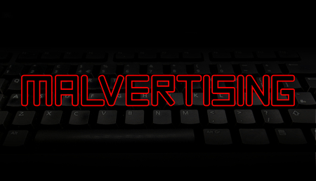 Malvertising red text over black keyboard illustration 版權商用圖片