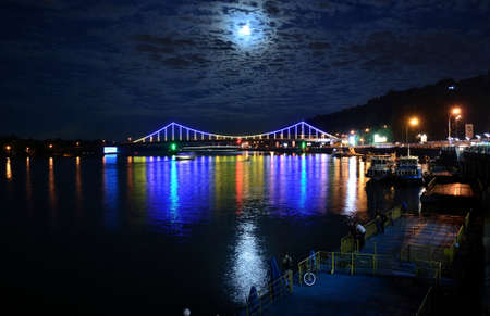 dnipro: Kiev River Port, multicoloured Dnipro and Pedestrian bridge The Park Bridge at night