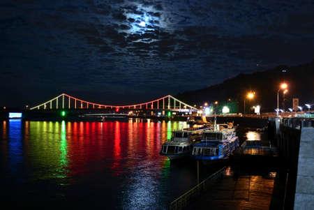 kyiv: Kiev River Port and Pedestrian bridge The Park Bridge at night Stock Photo