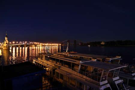 waterbus: Water-bus in Kiev River Port and Havansky Bridge at night Stock Photo