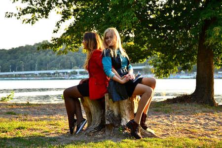 two girls: Two girls communicate outdoors near river