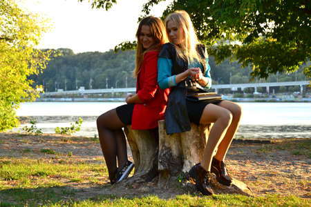 two girls: Two girls outdoors back to back