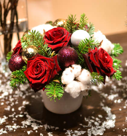 flower tree: Christmas bouquet with roses, fir, Christmas tree balls and artificial snow