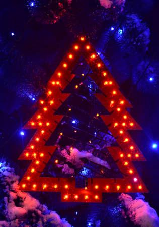 luminous: Luminous toy Christmas tree in snow