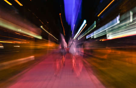 Night city accelerating blurred motion walking people. Speed ??concept