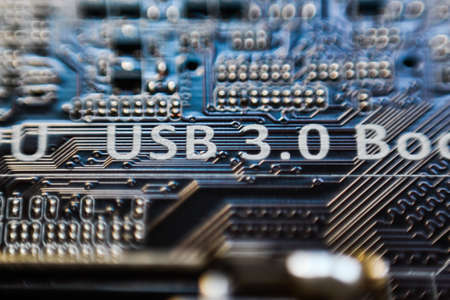 micro chip: USB 3.0 inscription on motherboard micro chip circuit Stock Photo