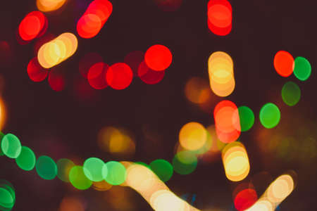 multicolored blurred christmas lights red green yellow orange