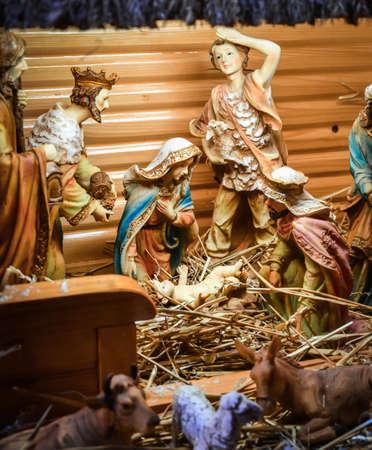 christmas manger scene with figurines including jesus mary joseph sheep and magi stock