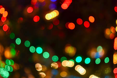christmas lights background blurred electric garland on christmas tree red green yellow