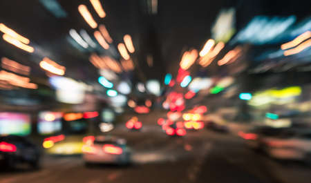 Night city street traffic lights background. Blurred motion