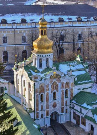 The Gate Church of the Holy Trinity in Kiev Pechersk Lavra Monastery in winter. 12th, 18th century, Ukrainian Baroque Stock Photo