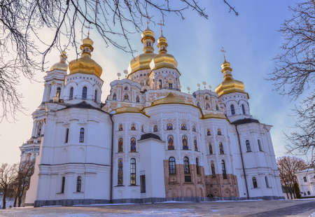 lavra: Dormition Cathedral of Kiev Pechersk Lavra Christian Monastery and Great Lavra Bell Tower in winter