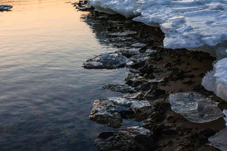 winter thaw: Melting ice coast close up