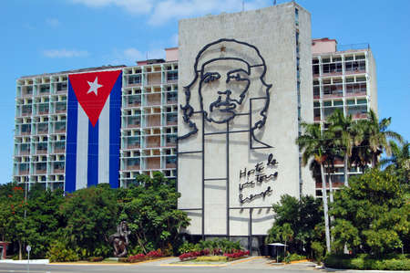 Havana, Cuba - January 2009: Cuban flag and sculpture of Che Guevara on facade of Ministry of Interior, Plaza de la Revolucion, Havana, Cuba on the 50th anniversary of the revolution